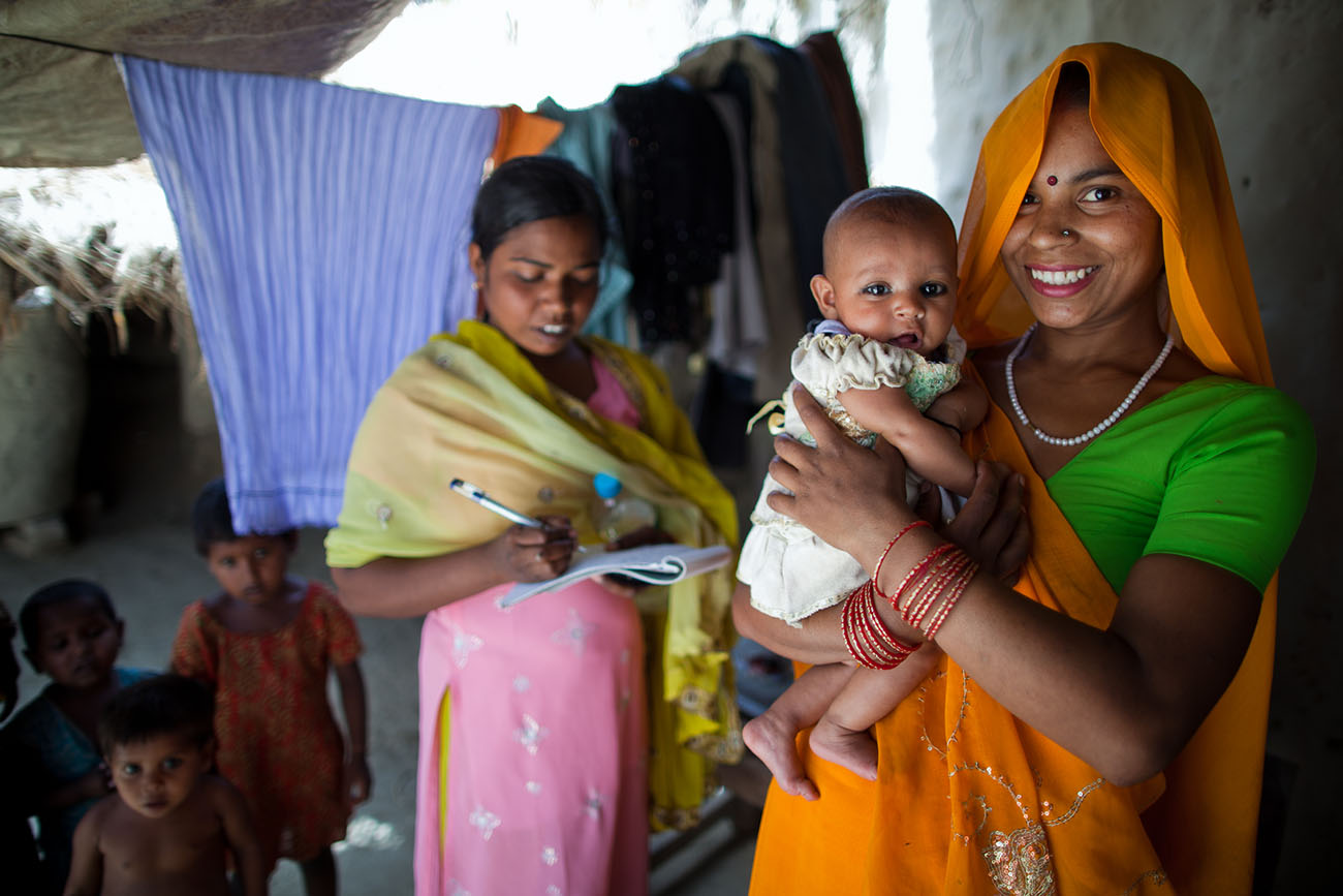 Indian baby and mother, happy to receive healthcare.
