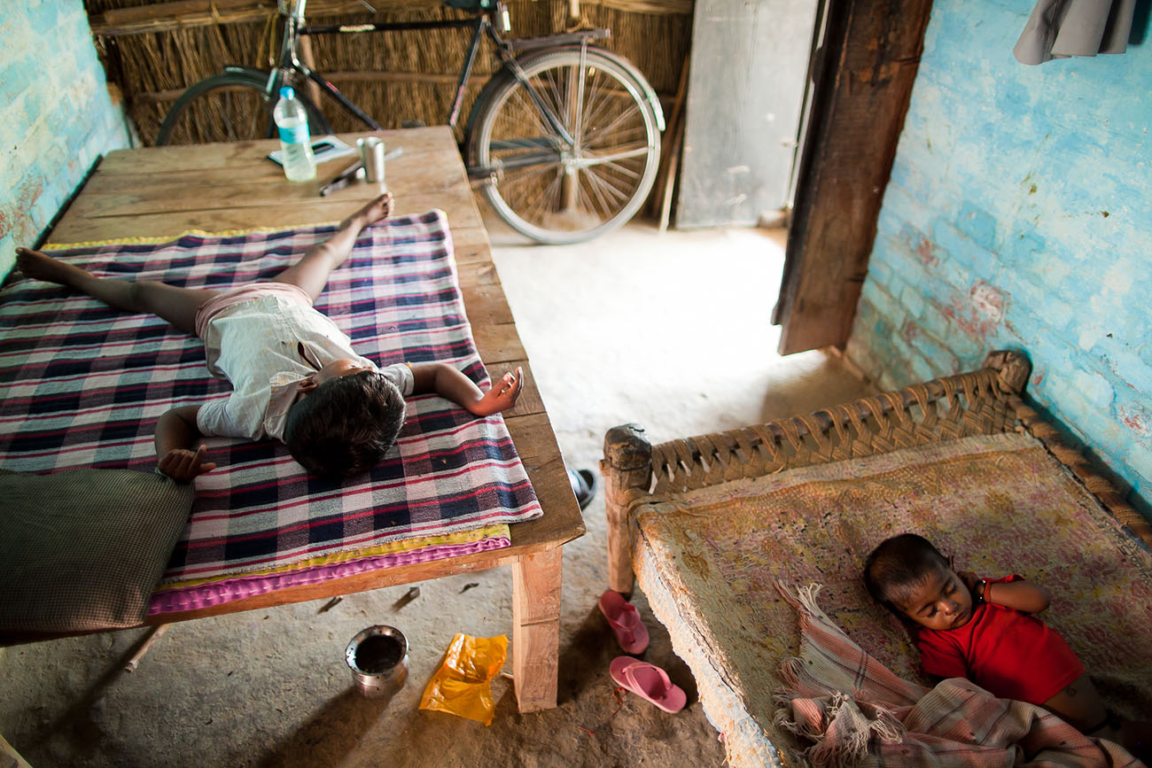 Children getting their mid-day naps in India.