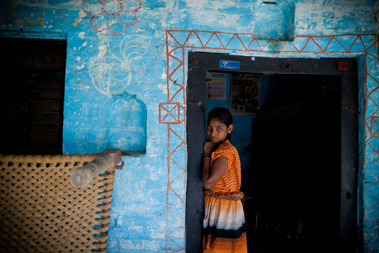 A young Indian woman awaits health care in India.