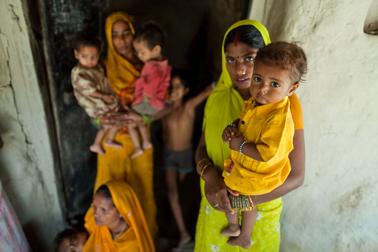 Indian mothers awaiting maternal care with their children.