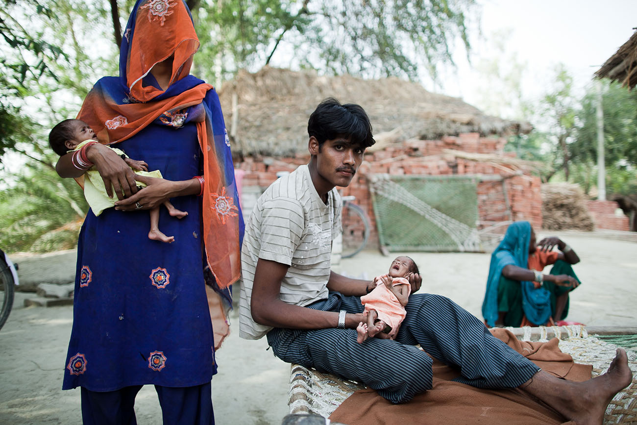A young Indian couple with newborn babies in need of health care.