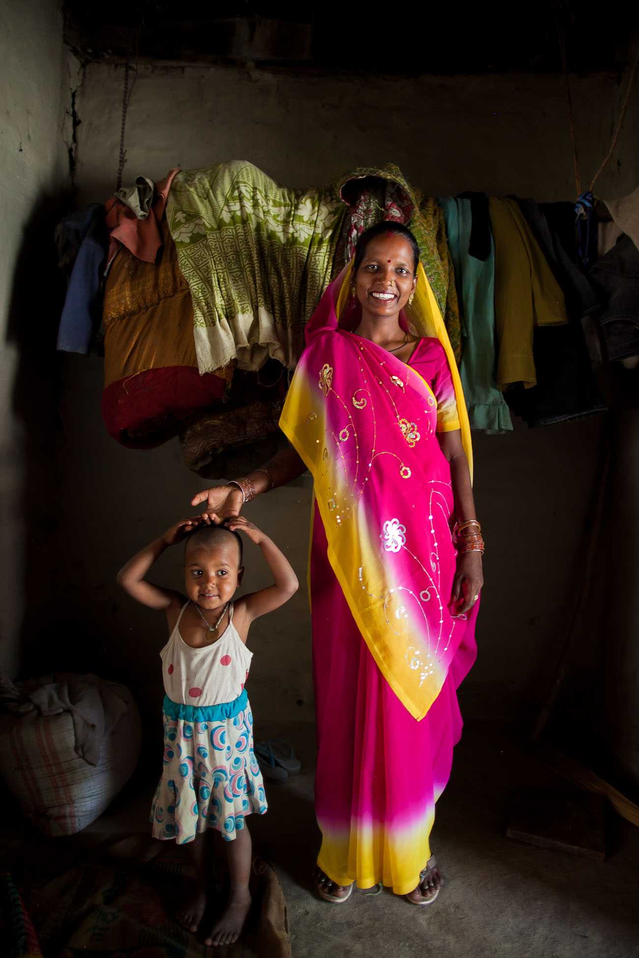 A happy mother in India with her young child.