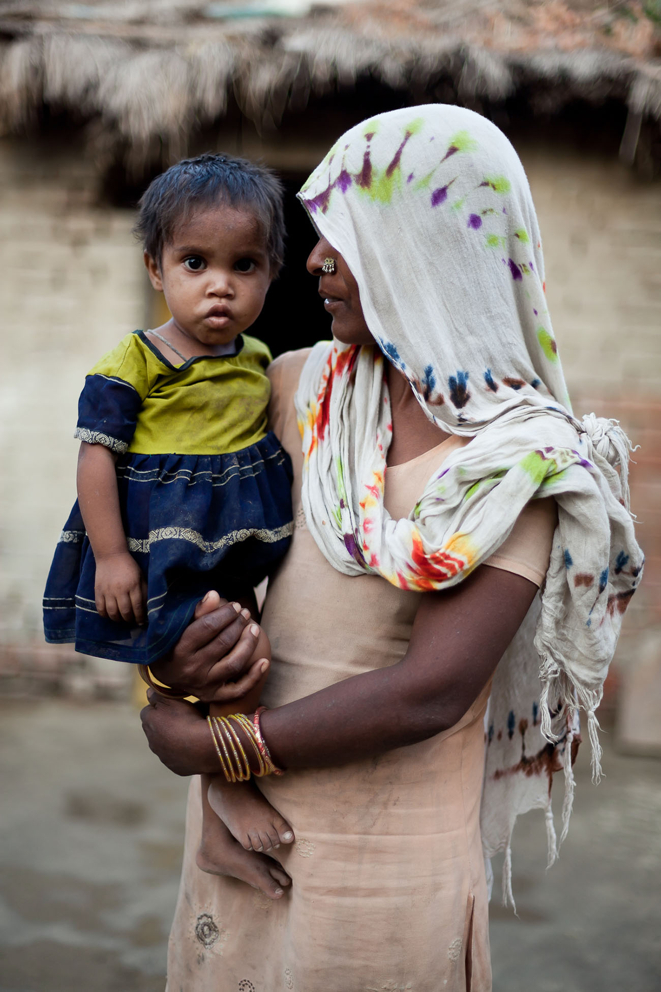A woman in India holding her child.