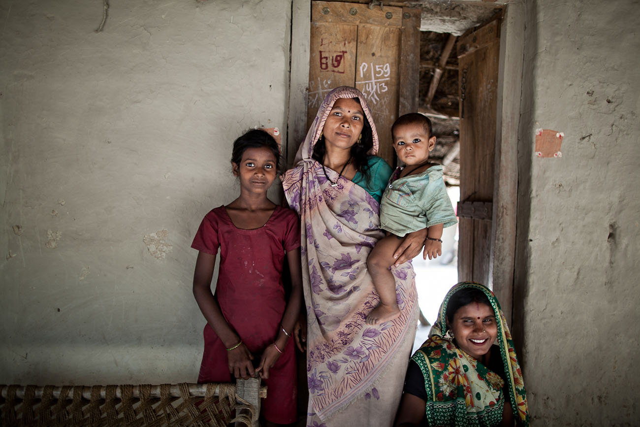 An Indian woman poses with her children.