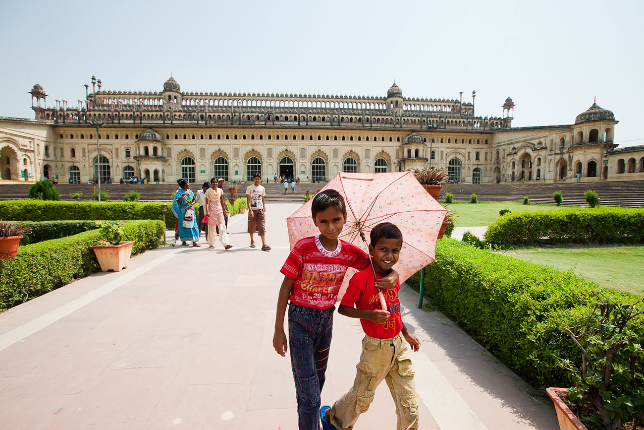 Children posing for a photograph outside a palace in India.