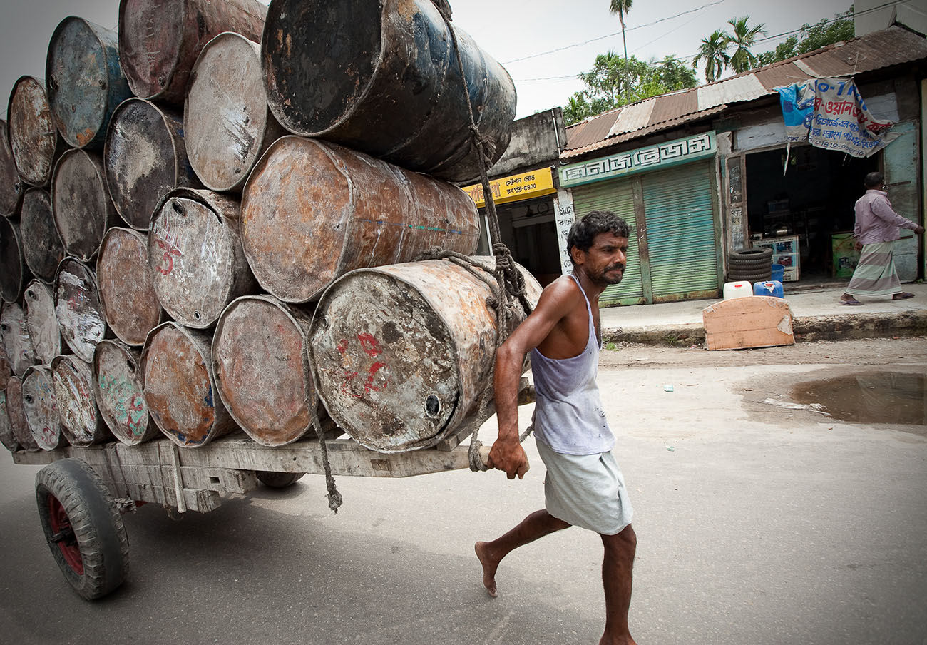 Used drums (perhaps for oil) get repurposed or recycled in Bangladesh.