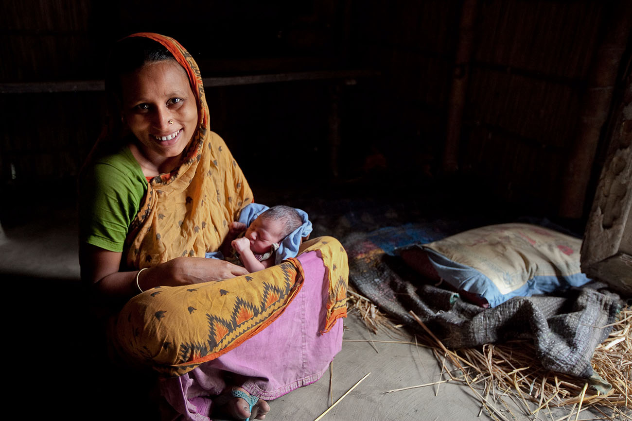 A mother in Bangladesh holds her sleeping baby.