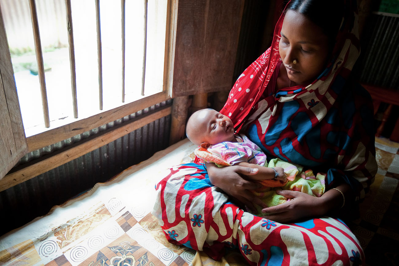 A mother in Bangladesh holds her baby.