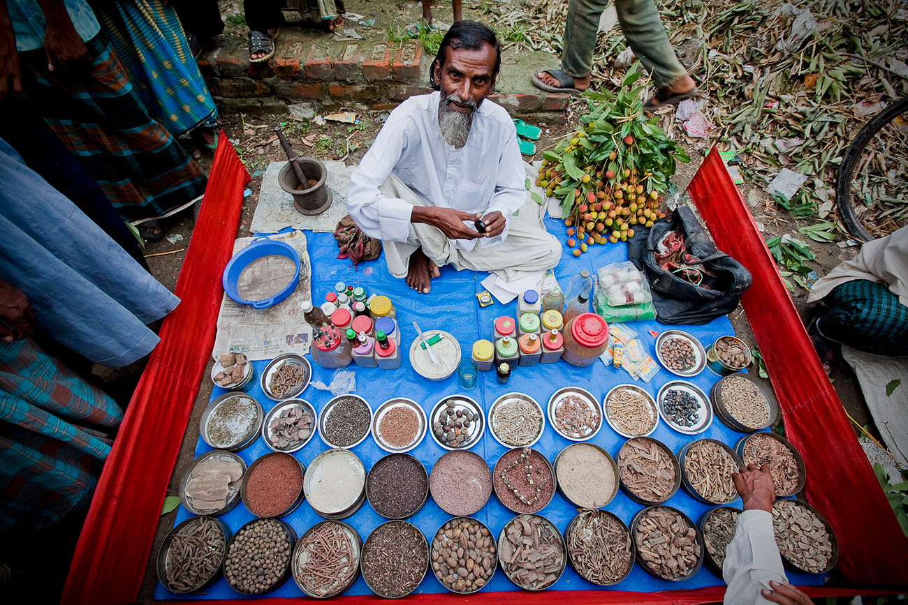 A medicine man in Bangladesh has his ingredients and tools laid out for all to see.