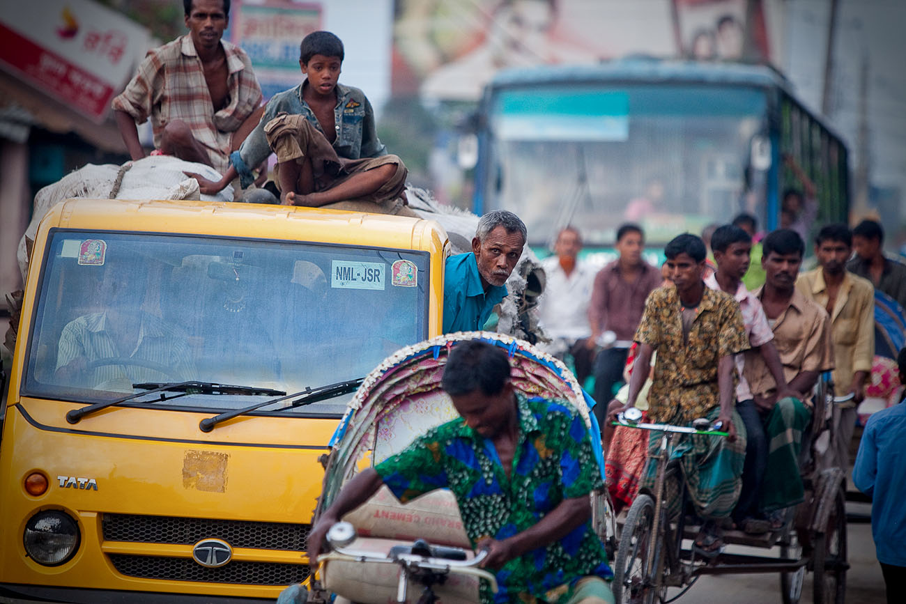 City streets in Bangladesh are filled with people on bicycles, cars, and a variety of other means of transportation.