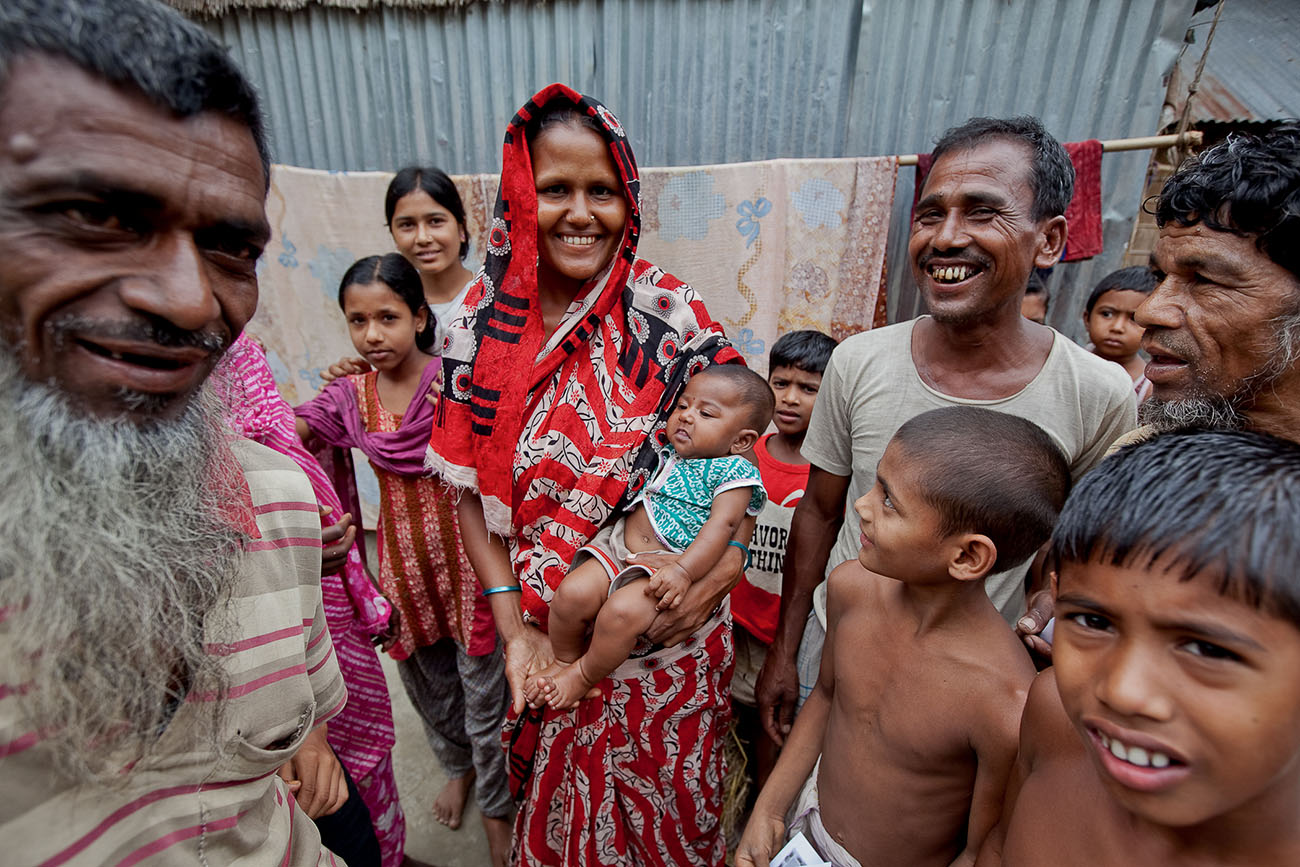 People pose for a photograph in Bangladesh while waiting to get healthcare.