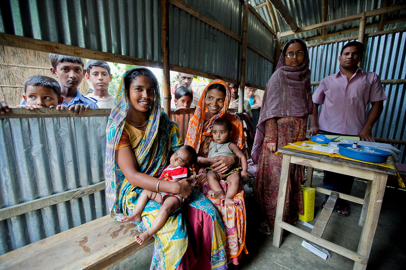 Bangladeshi women bring their children in for healthcare.
