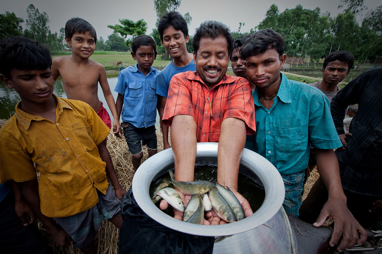 Fishermen in Bangladesh display a small bit of their catch.