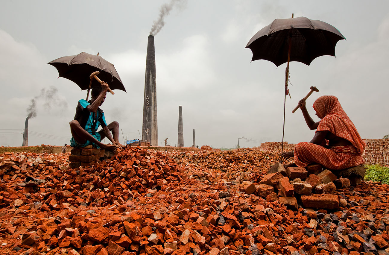 People break bricks in Bangladesh to earn a meager living.
