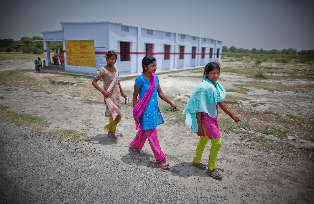 Young Indian girls walking down a road.