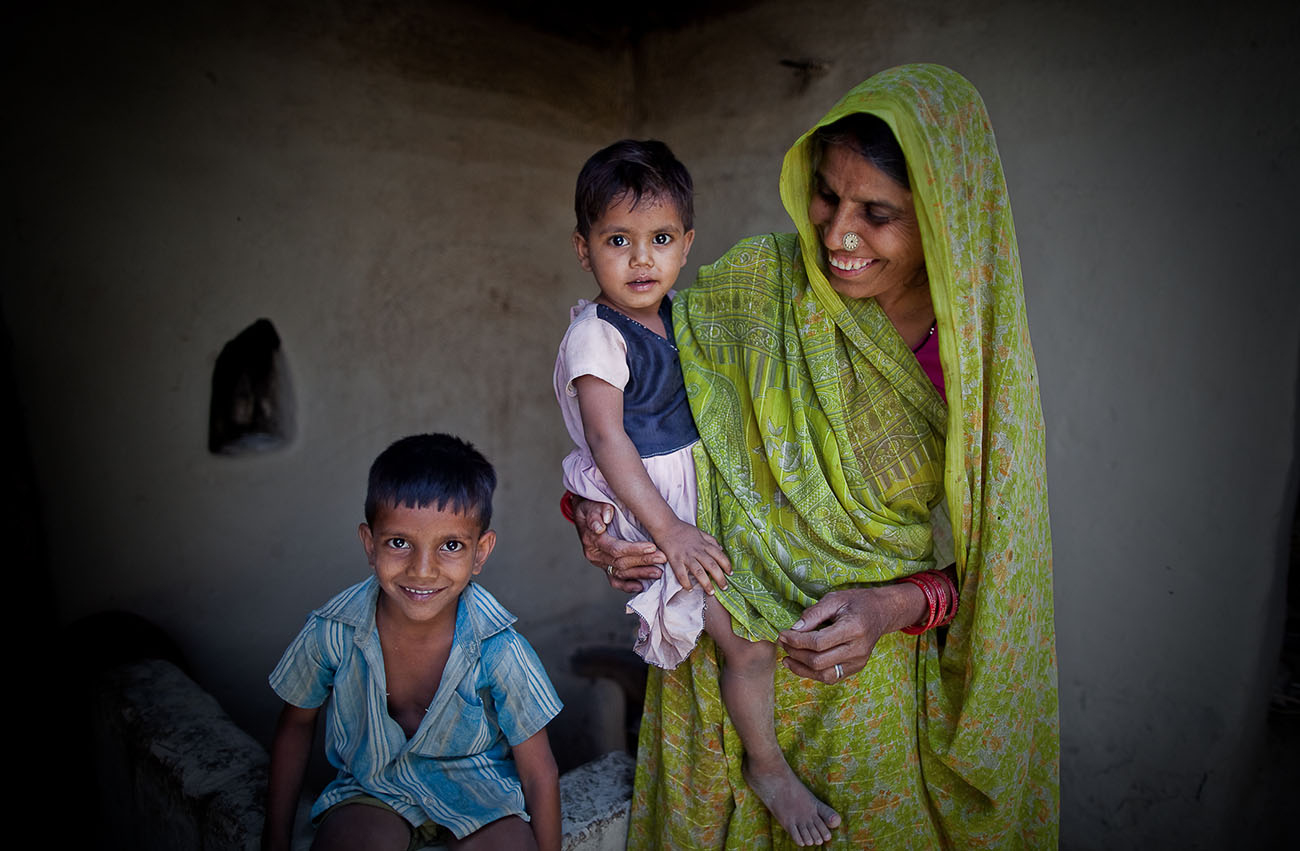 An Indian family is happy to receive healthcare for the mother and children.