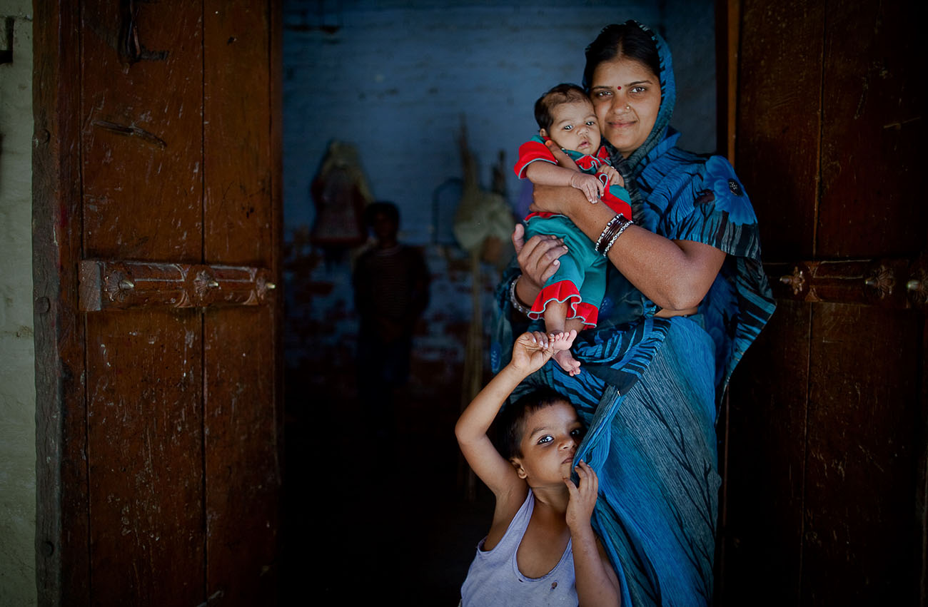 A family in India is happy to receive maternal healthcare.