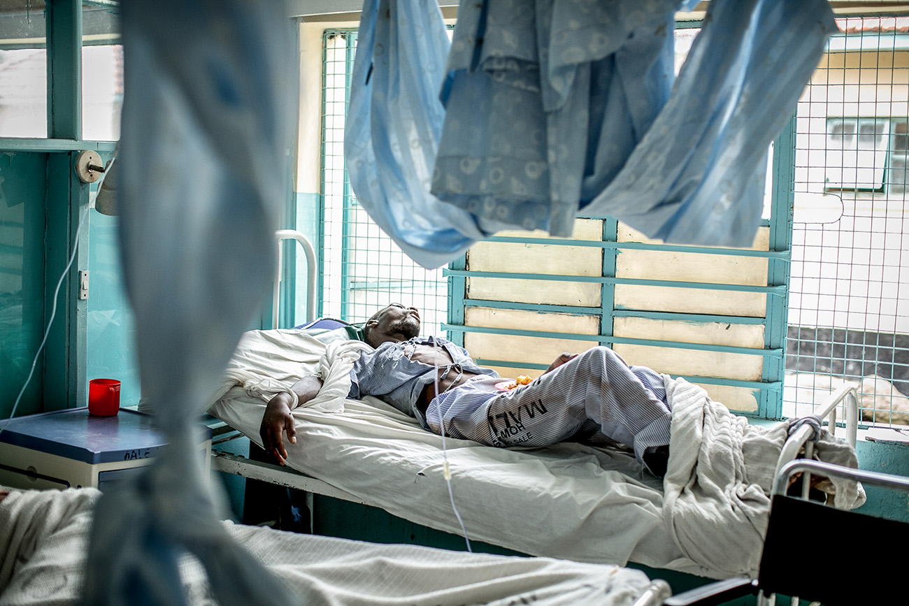 A patient waits to be examined in the tuberculosis ward in the government hospital in Naivasha, Kenya.
