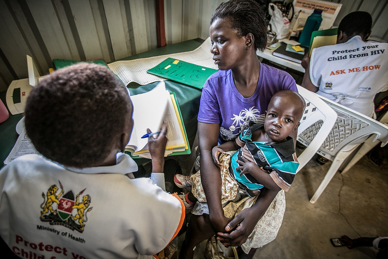 A mother and child being screened for HIV in a rural clinic in Kenya.