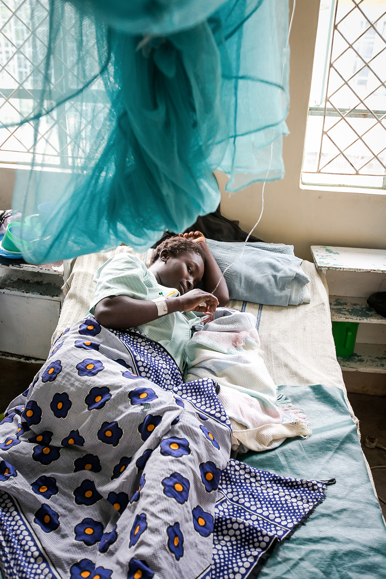 A mother and her newborn daughter in a rural clinic in Kenya.
