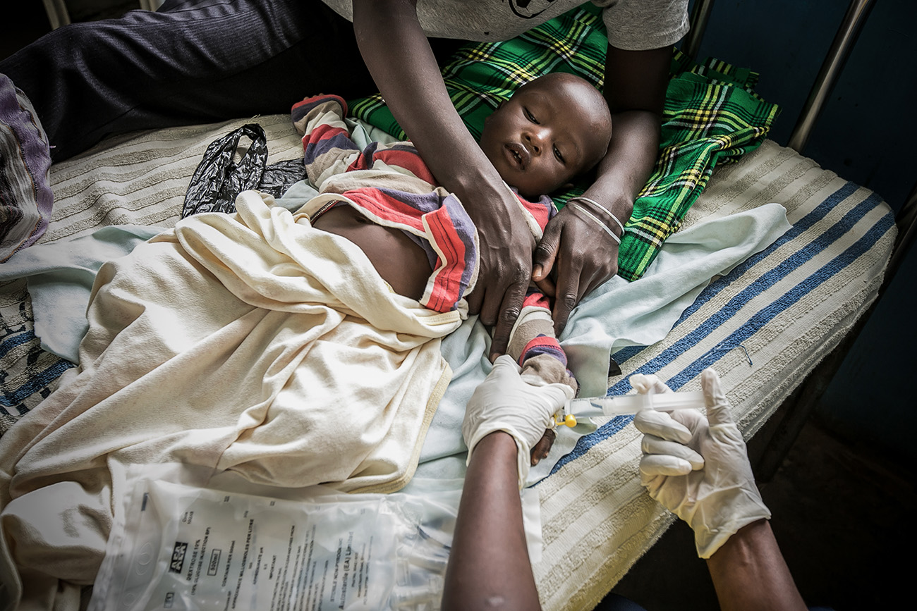 A child receiving intravenous medication in a clinic in rural Kenya.