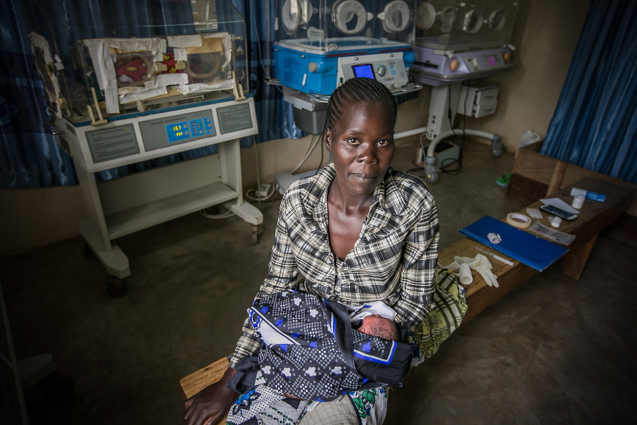 A premature infant born in a hospital held by her mother in rural Kenya.