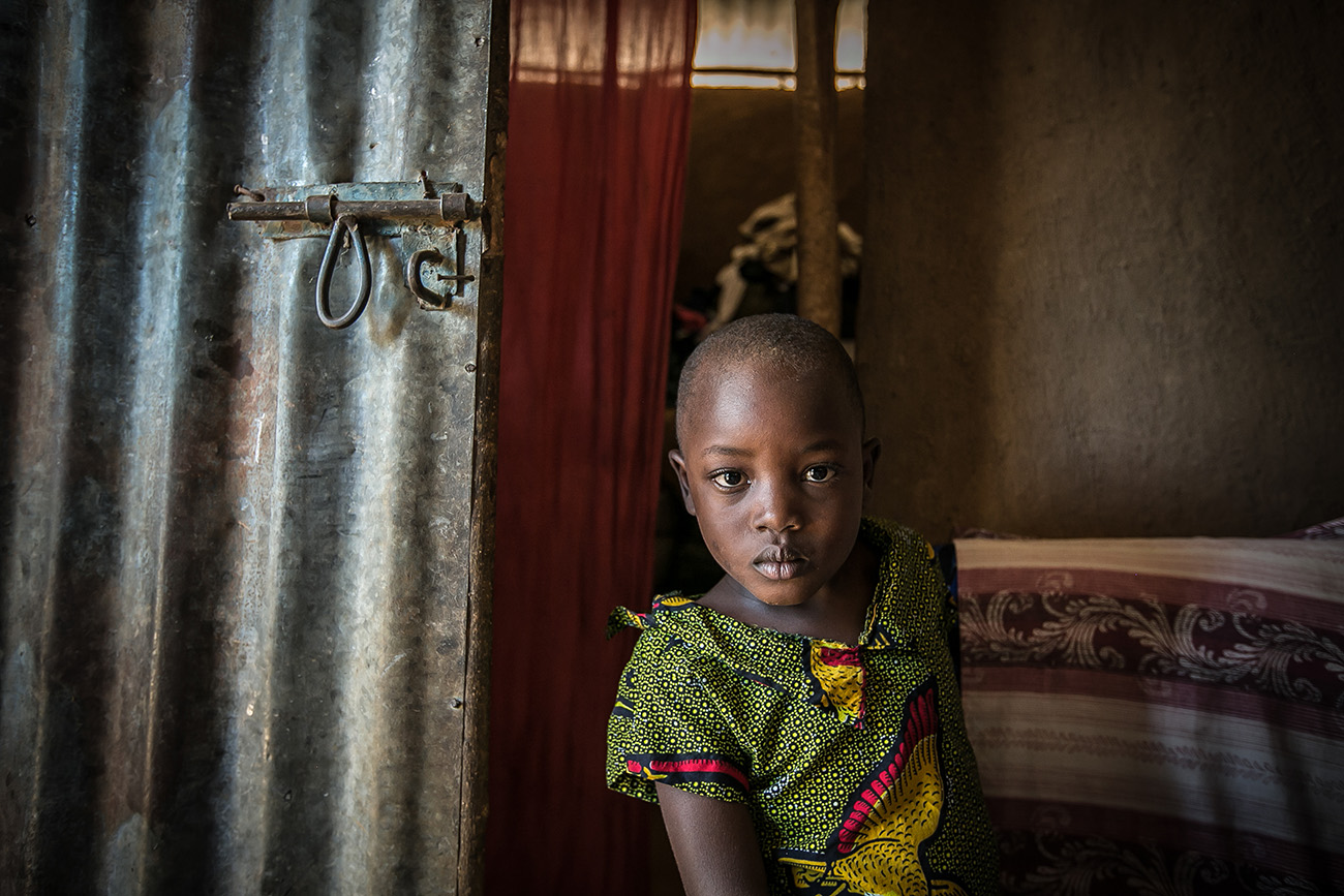 A child in her home in a village in rural Kenya, which has one of the highest birth rates in the world.
