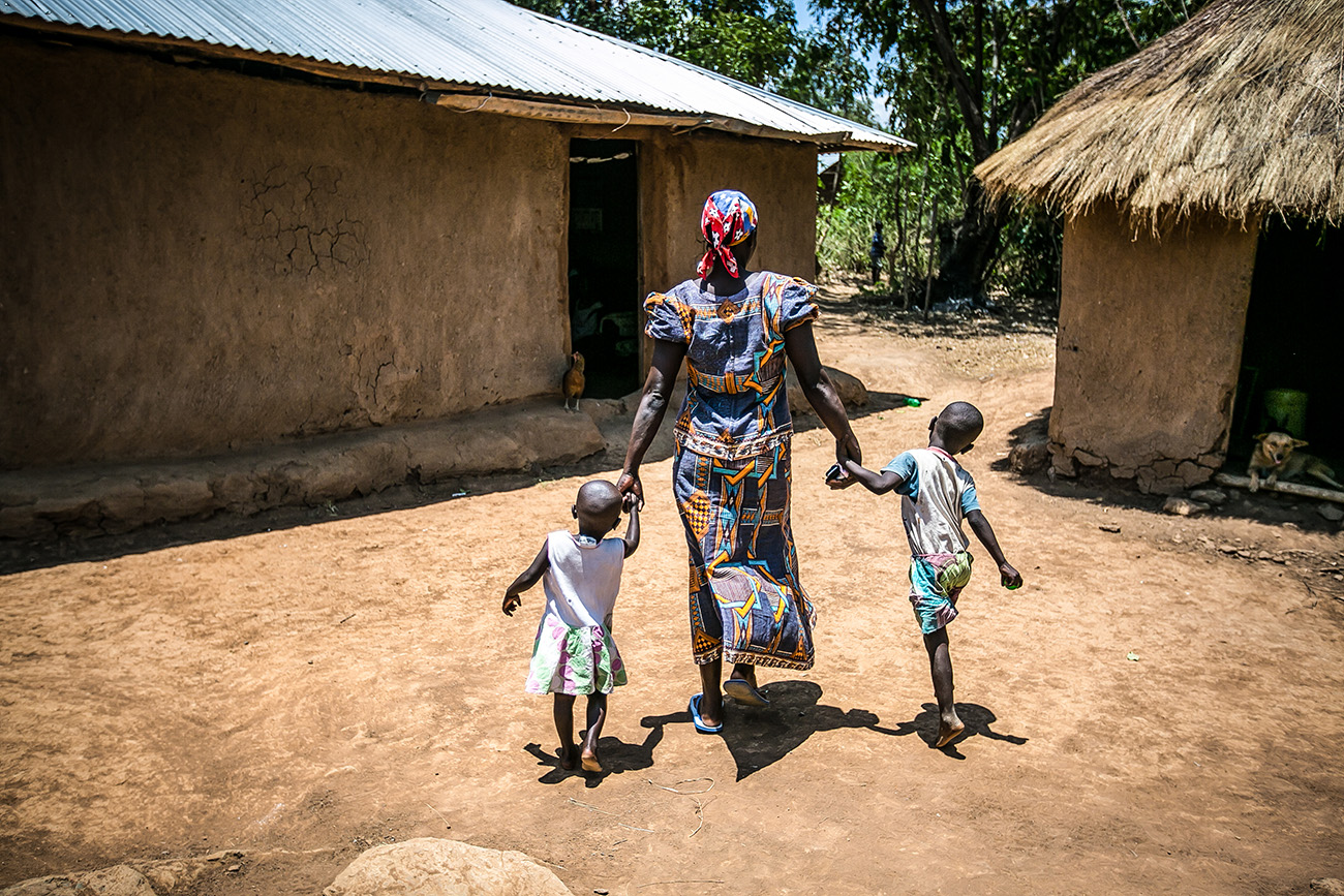 A mother and her two young children in a village in Kenya.