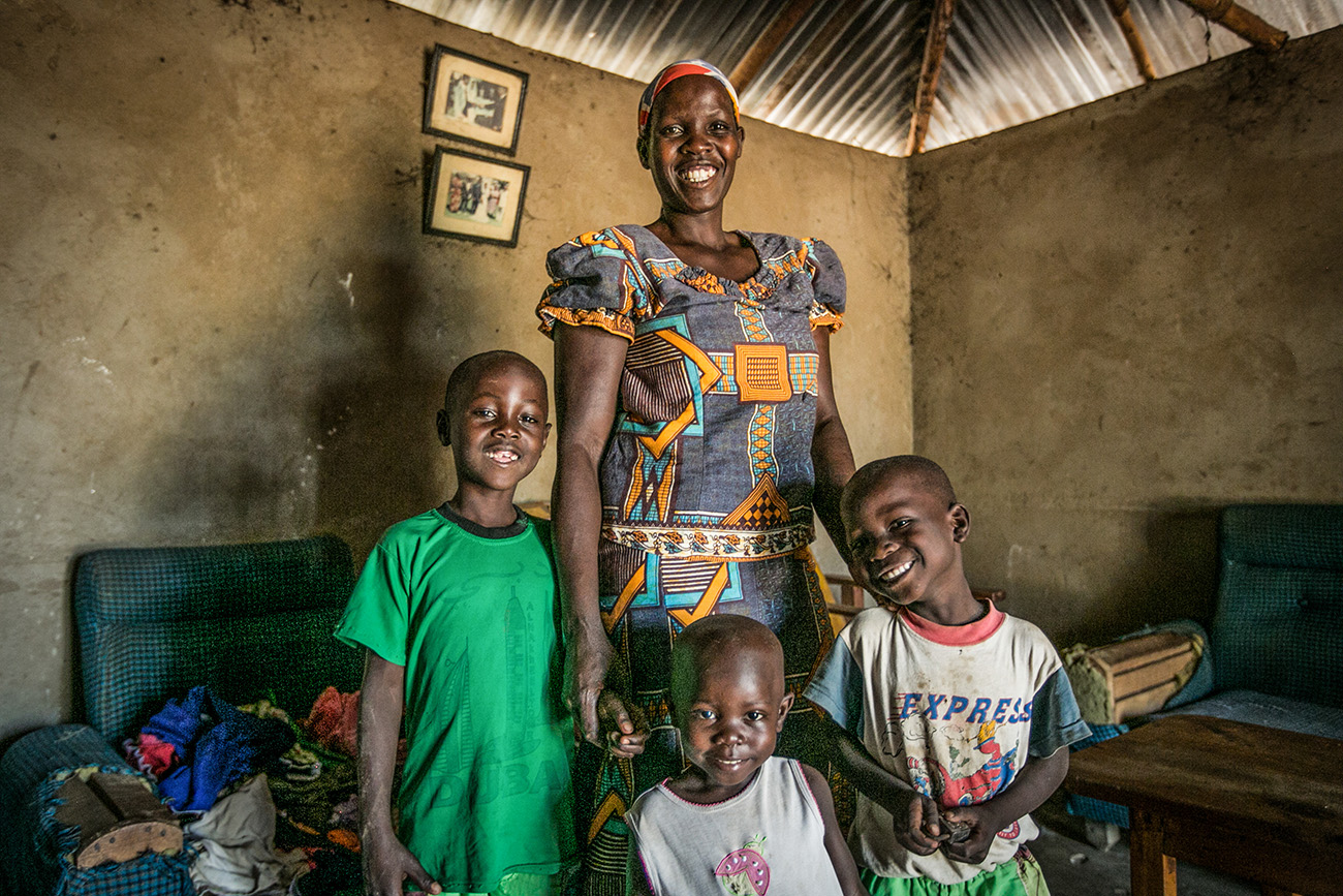A mother and her three children in their home in a village in Kenya.