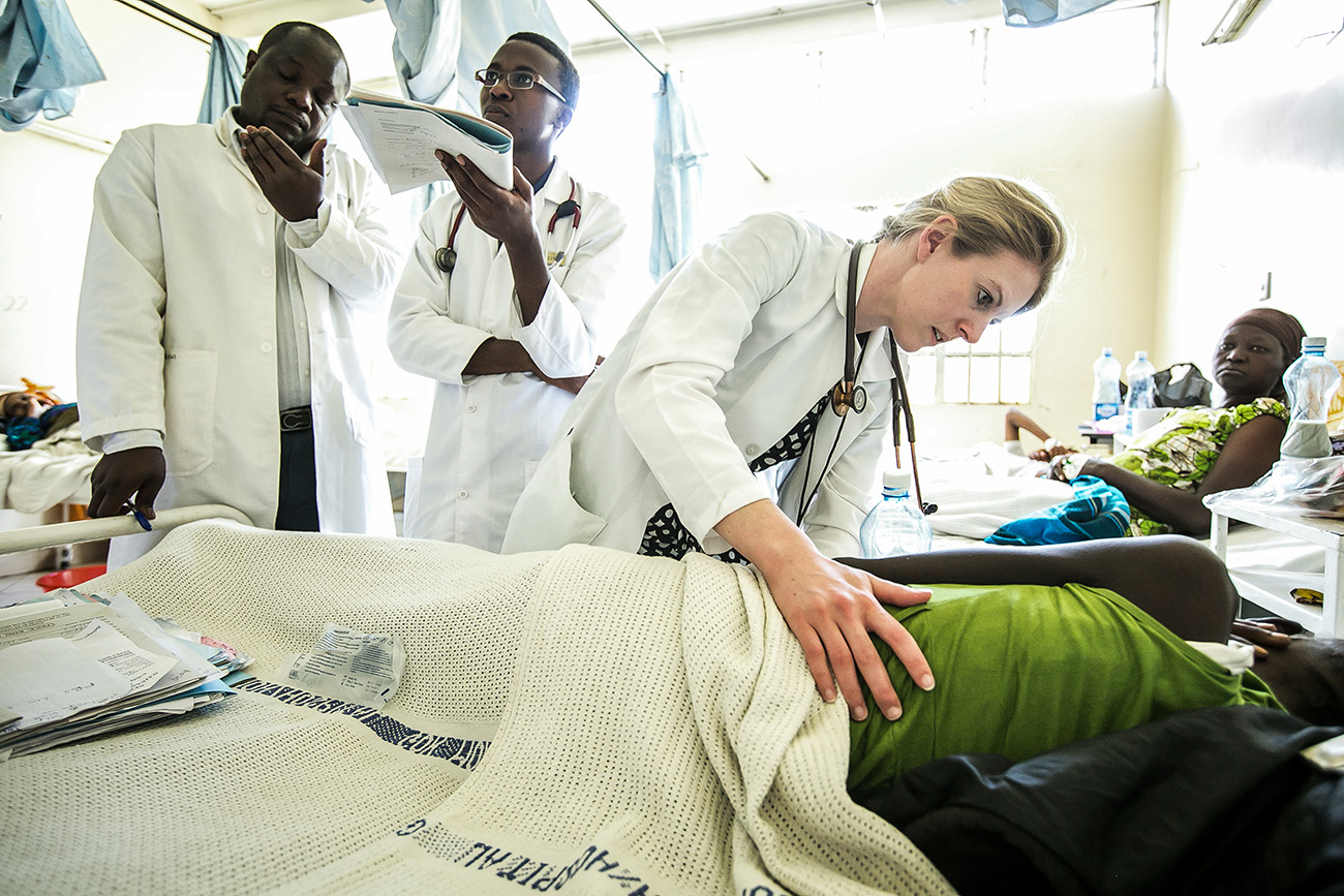 Patient examination while in hospital bed in a Kenyan clinic.