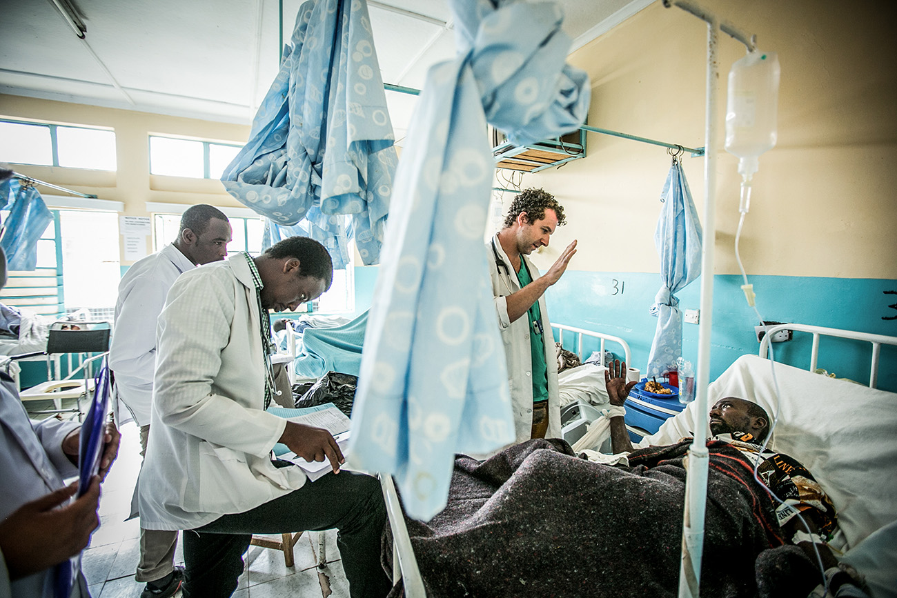 A doctor from the University of Washington and medical students from Kenya visit patients in the tuberculosis ward in the government hospital in Naivasha, Kenya.