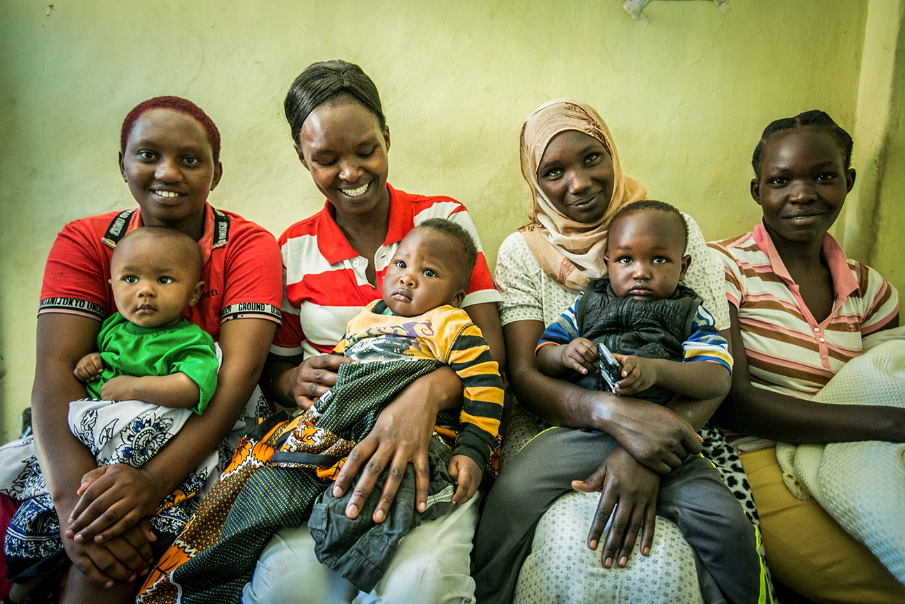Residents of a slum wait to see a doctor in the clinic in Naivasah, Kenya.