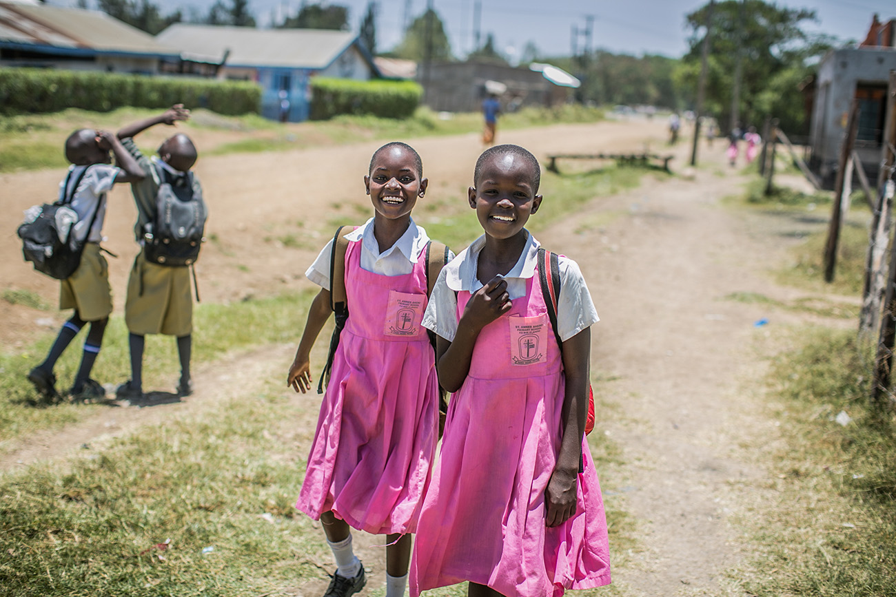Schoolchildren on their way home in rural Kenya.