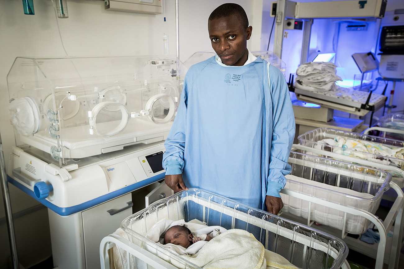 A father and his newborn daughter in the neonatal unit in a hospital in Nairobi, Kenya.