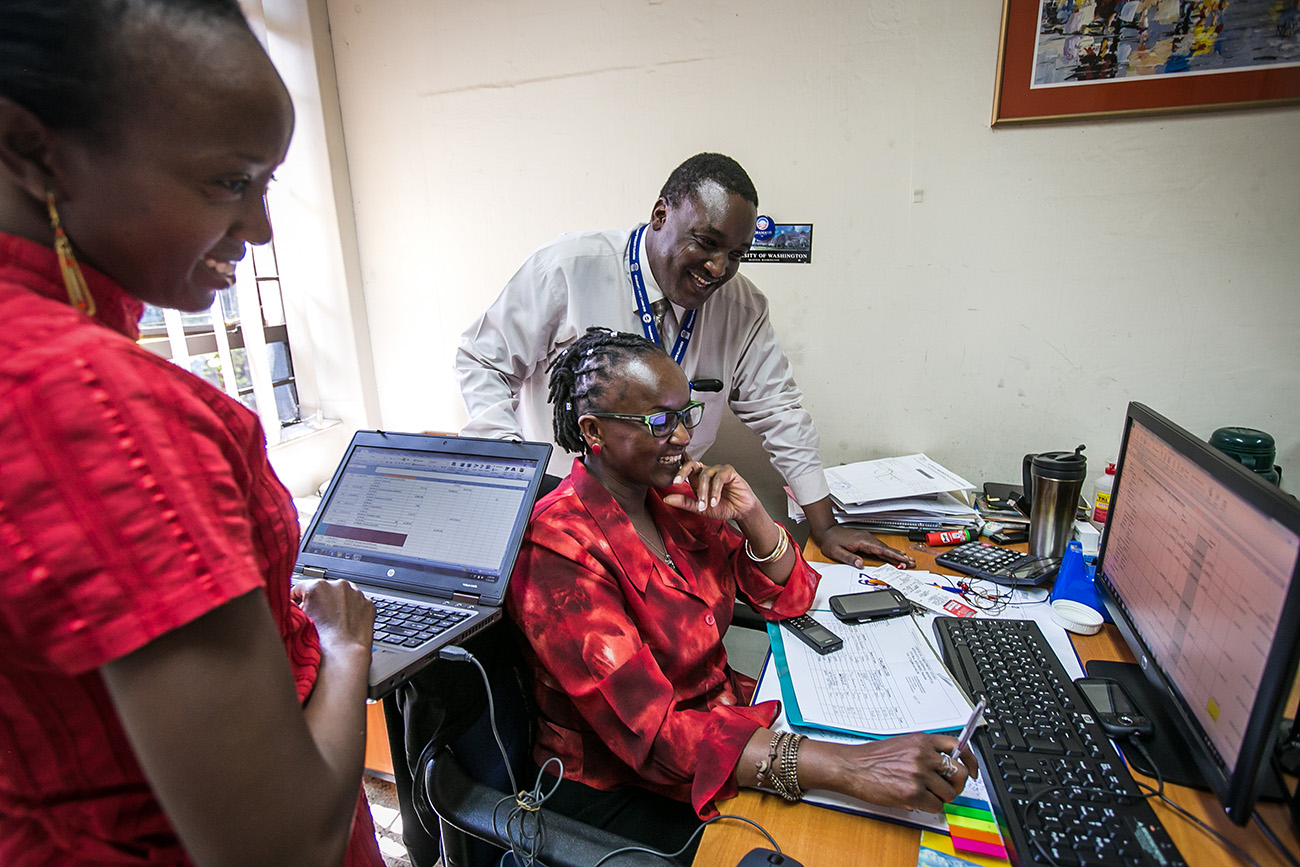 Dr. John Kinuthia, a medical researcher with the University of Washington based in Nairobi, Kenya, works with his staff.